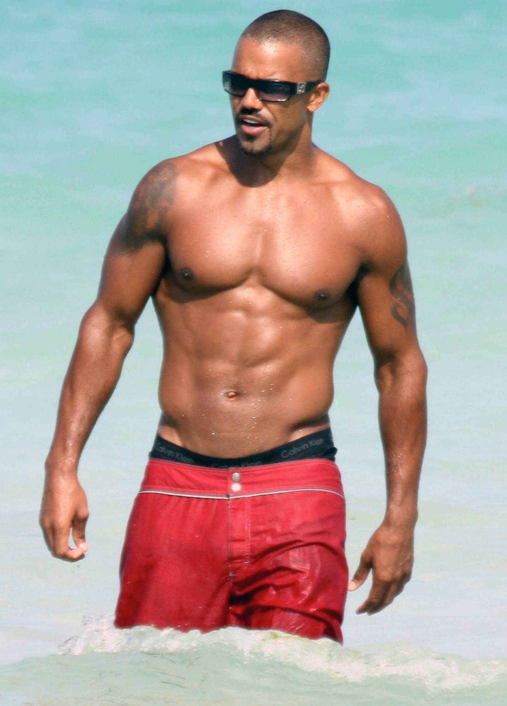 """e8be0d3b5aff1 Shemar Moore Beach. EXCLUSIVE!! """"Criminal Minds"""" star Shemar Moore shows of his  beach bod in a pair of red swim trunks that slipped down revealing ..."""